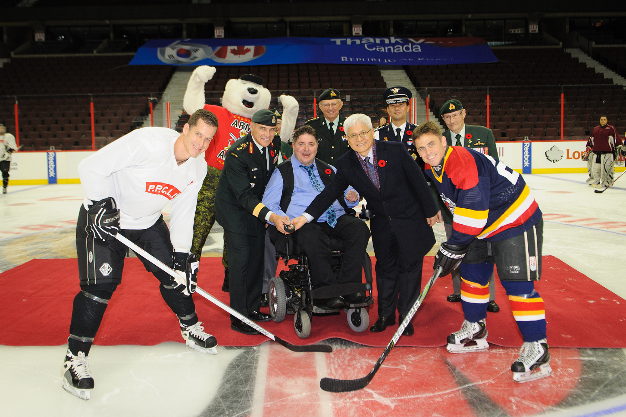 dropping the puck at the Imjin Classic hockey game