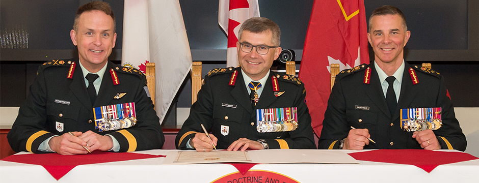Slide - Major-General Simon Hetherington (left) assumes command of CADTC from Major-General Jean-Marc Lanthier (right) presided by Lieutenant-General Paul Wynnyk (centre), Commander Canadian Army