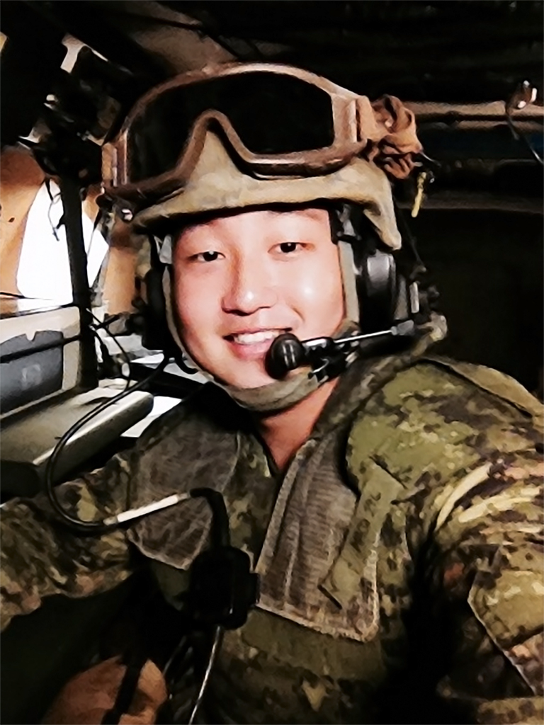 Captain Hyunjoon (Dave) Jung (then Lieutenant) inside a Bison armoured vehicle during a field exercise in the summer of 2013 in the Canadian Forces Base/Area Support Unit Wainwright training area, Alberta.
