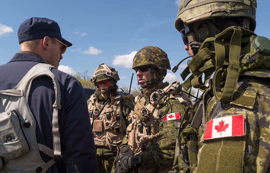 Soldiers from 2 Military Police Regiment interact with role players in a fictional village during Exercise MAPLE RESOLVE on May 18, 2017. Role players add a high level of realism to the exercise and one of the officers behind planning the exercise says troops have proven to be well-prepared for its challenges. Photo: Sergeant JF Lauzé, 4th Canadian Division Support Base Petawawa. ©2017 DND/MDN Canada.