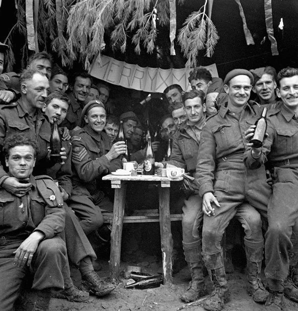 Canadian soldiers enjoying a few drinks on Christmas Day 1943 at Ortona, Italy.