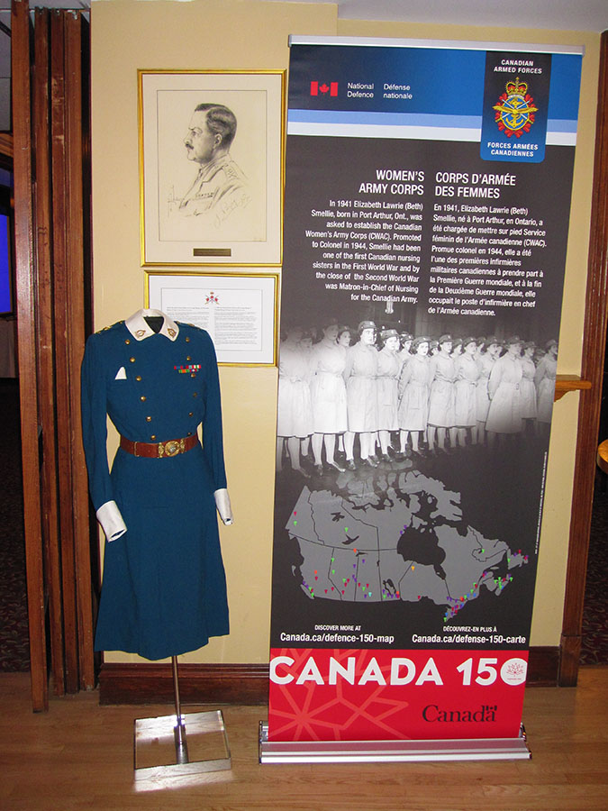 The Canada 150 banner featuring The Women's Army Corps and Colonel Elizabeth Smellie, first woman Canadian Army Colonel with a Second World War nursing uniform provided by Major Bryan Mialkowsky at the unveiling of Col Smellie's portrait at the Army Officers' Mess in Ottawa on May 25, 2017.