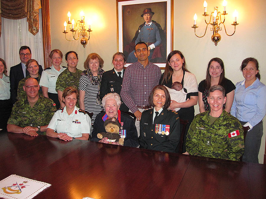 Current and former Canadian Armed Forces military nursing officers with 99-year-old Second World War Nursing Sister Betty Brown in front of Colonel Elizabeth Lawrie Smellie's newly-installed portrait at the Army Officers' Mess in Ottawa on May 25, 2017. Front row sitting, left to right: Major (now Lieutenant-Colonel) Daniel Dupuis, Colonel Gisele Fontaine, Nursing Sister Betty Brown with Vimy 100 bear, Lieutenant-Colonel Carolyn Blanchard, Major Trisha MacLeod. Second row standing, left to right:  Captain Kirsten MacFadyen, Captain Daniel Boislard, Captain Karoline Martin, Major Edith Arbour, Major Julie Levesque, Ms. P. Gail Harrod, Major Yvonne Brierley, Major Tony Singh, Captain Stephanie Chan with her baby, Sub-Lieutenant Leslie Southen and Lieutenant Breanne Locking.