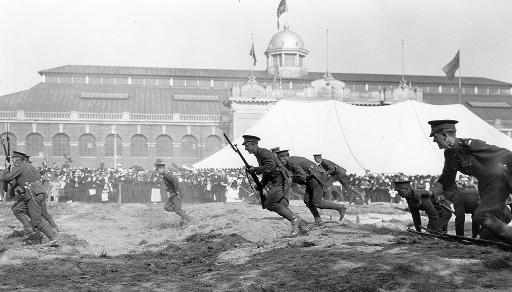 Members of the Canadian Armed Forces conduct a charging demonstration at the Canadian National Exhibition during World War I.