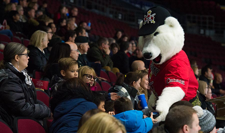 Juno the Bear handing out commemorative pucks to the young fans at the TD Place in Ottawa. 