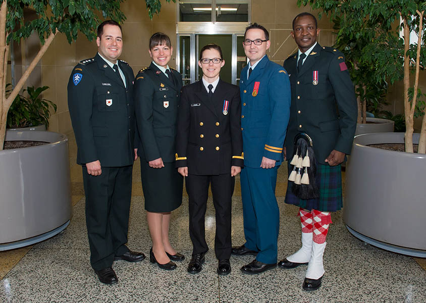 The graduating class of the Canadian Army Reserve Basic Public Affairs Officer Course stands in the main foyer of the National Printing Bureau in Gatineau, Quebec on June 12, 2015. (Left to Right) Captain Derek Picard-Fortin, Captain Valérie Harvey, Acting Sub-Lieutenant Marie-Jil Coudé, Captain Nathan James, Second-Lieutenant Felix Odarty-Wellington.