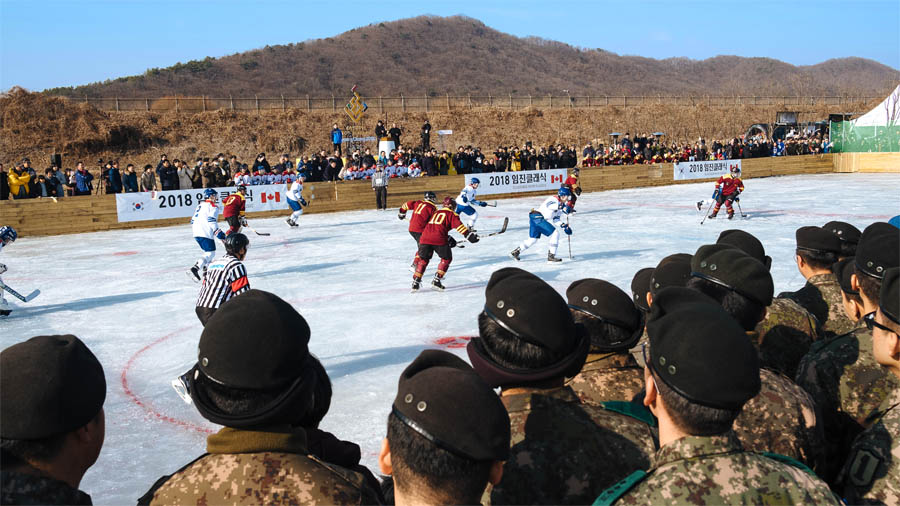 "Korean Army members attentively watch ""Team Canada"" made up of members of Princess Patricia's Canadian Light Infantry and Royal 22e Régiment, and Canadian expats as they take on ""Team Corea"", made up of players from Yonsei University and Korea University in Paju City, South Korea on January 19, 2018.