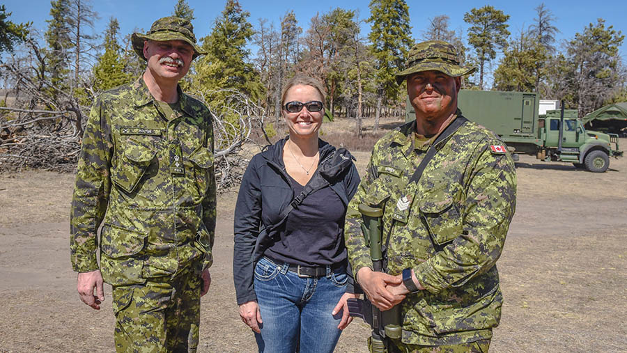 Sergeant Taylor Warren, right, pictured with both his military and civilian bosses: Fort Garry Horse Commanding Officer Lieutenant-Colonel Dave Koltun and Canadian Border Services Agency Superintendent Julie Baines during Exercise ARMOURED BISON 2018 held at CFD Dundurn on April 28, 2018.