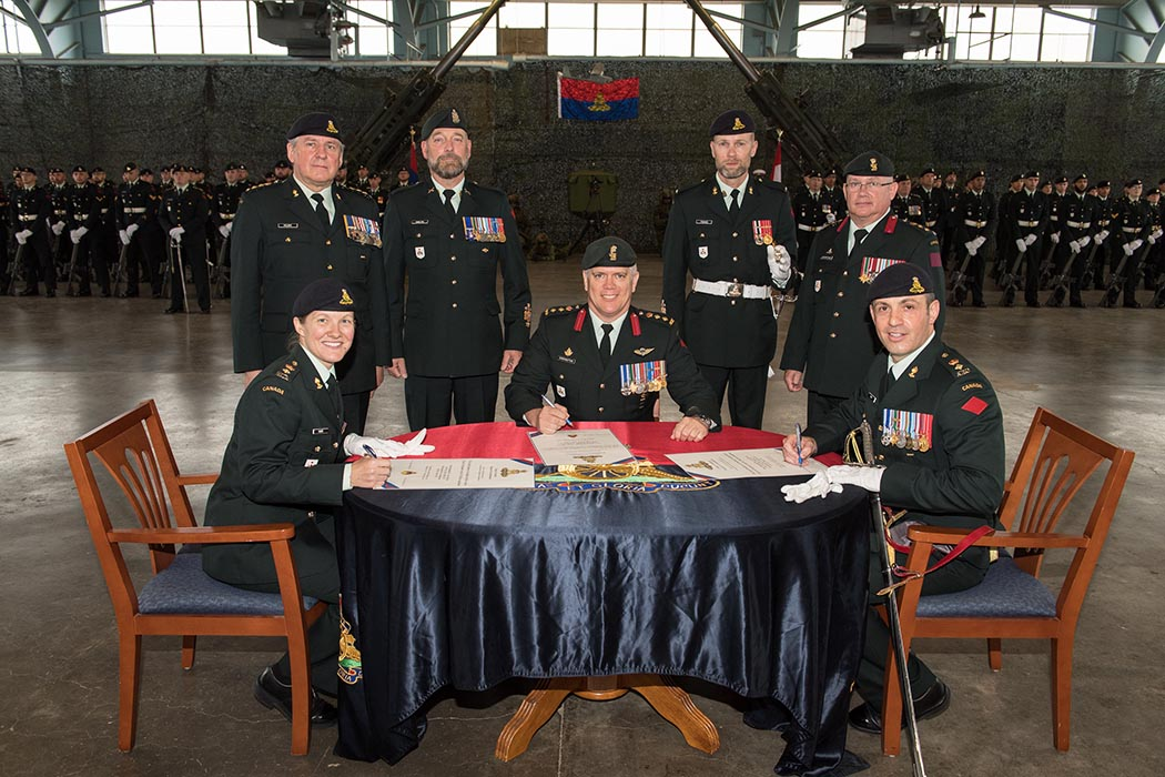 The Change of Command scrolls are signed