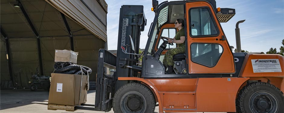 Slide - Soldier using a forklift